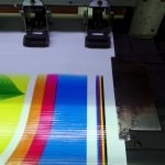Printing machine printing a upvc banner